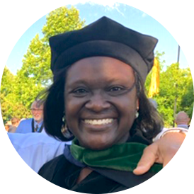 Dr. Tetteh in cap and gown at commencement.