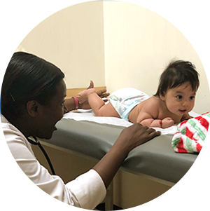 Dr. Tetteh examining an infant